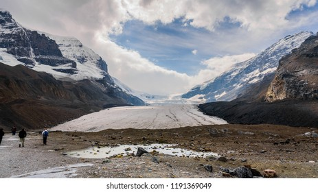 Jasper National Park, AB / Canada - September 1 2018: Hikers walking towards Athabasca Glacier