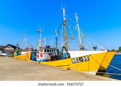 JASTARNIA PORT, POLAND - JUN 21, 2016: traditional fishing boats anchoring in Jastarnia port on sunny summer day, Hel peninsula, Baltic Sea, Poland