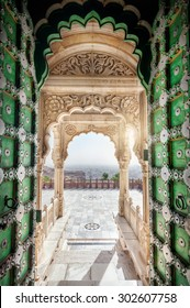 Jaswant Thada memorial with opened green door with view to Jodhpur city in Rajasthan, India