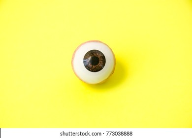 Jaundice or icterus - a symptom manifestations of liver disease in the eyes concept photo. Anatomical model of the human eye is on a yellow background, and sclera reflected yellow color