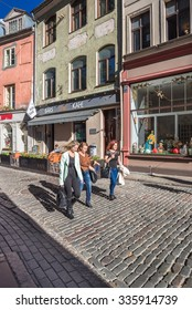 Jaunieala street, Old Town of Riga, Latvia-October 2, 2015: Attractive, well preserved and restored buildings in the historic center of the city now housing offices, cafes, restaurants and shops.