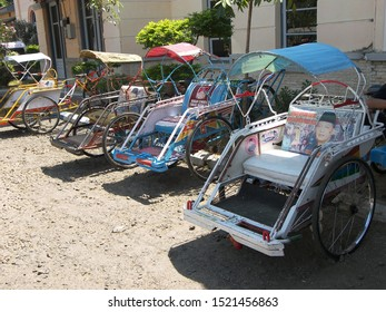 JAVA, ASIA - August 2008: touristic trip. Travel view of Java featuring Java tuc tuc taxi parking. The image location is Java in Asia.