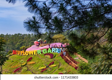 Java, Indonesia - July 13, 2018: Batu Flower Garden (Spot Bukit Bulu) in Coban Rais park with people taking selfie. Popular instagramable place on family holidays. Travel destination in Kota Malang