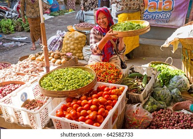 JAVA, INDONESIA - SEPTEMBER 18, 2016: Women selling vegetables on the local market on the 18th of september 2016 in Java Indonesia