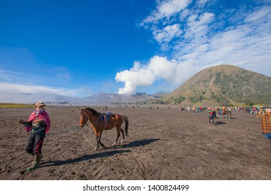 JavaIndonesia-Arpil 21 2019 : A horseman at Mount Bromo of Bromo-Tengger-Semeru National Park in Indonesia.