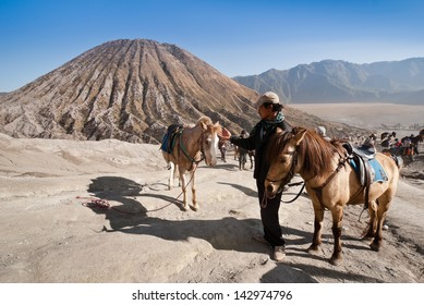 JAVA,INDONESIA-AUGUST 11:Indonesia man with the horse for tourist rent at Mount Bromo on August 11,2009 in Java , Indonesia.Mt. Bromo is an active volcano and part of the Tengger massif, in East Java.