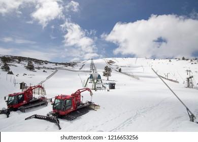 JAVALAMBRE SKI PISTES TERUEL SPAIN ON MARCH 2018: Snow machines at Empty Javalambre pistes on April 14, 2018 Teruel Aragon Spain