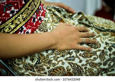 Javanese Groom Using Wedding Ring and Batik