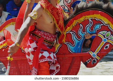 Javanese traditional dancer with horse bamboo woven as property.