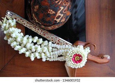 Javanese Traditional Man wearing Keris and Blangkon, the flowers is used in ceremonial usually