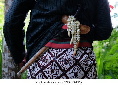 Javanese traditional weapon named Keris with colorful ornaments is worn as part of dressing during special event/Javanese traditional weapon/Javanese traditional weapon worn during special occasions.