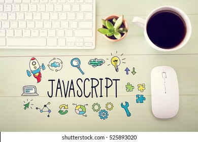 JavaScript concept with workstation on a light green wooden desk