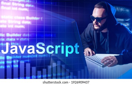 Javascript programming. Programmer next to the computer. Javascript logo in the foreground. Concept - writing code in Javascript. He is studying java programming language. Software developer.