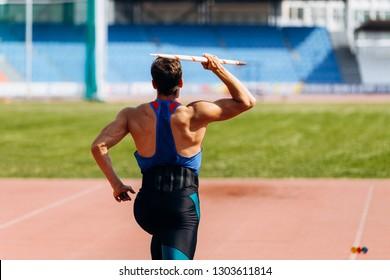 javelin throw athlete thrower running in track stadium