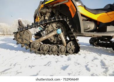 JAVORNIK, CZECH - 31 December 2016: Yellow Winter Scooter Mountain Services, winter scooter. Mountain rescue service