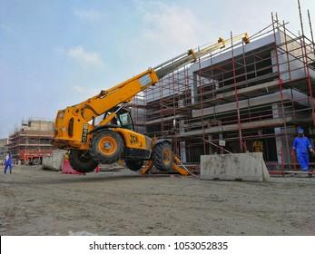 Jawaher Saadiyat Beach Villas, Abu Dhbai - 24th March, 2018: Construction Activities, JCB Telehandler stuck and lifted by its outriggers
