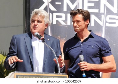 Jay Leno and Hugh Jackman at the ceremony honoring Hugh Jackman with Hand and Footprints in the courtyard of the Grauman's Chinese Theatre. Grauman's Chinese Theatre, Hollywood, CA. 04-21-09
