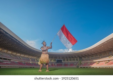 jayapura, Papua Indonesia, Portrait of a man and woman flying the red and white flag, August 03, 2019