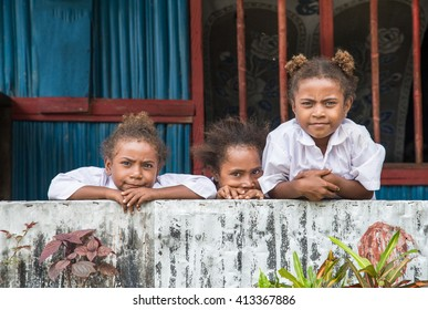 JAYAPURA, WEST PAPUA, INDONESIA - CIRCA FEBRUARY 2016: schoolgirls posing for a camera