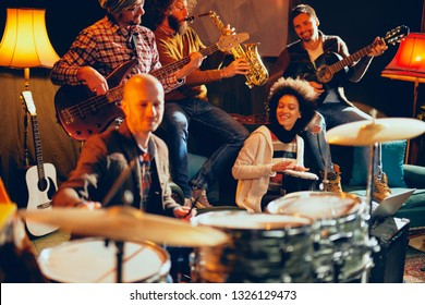 Jazz band playing music in home studio. Selective focus on drummer.