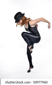 Jazz dancer in black tights launches into a jump