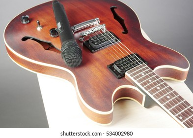Jazz electric guitar and microphone.