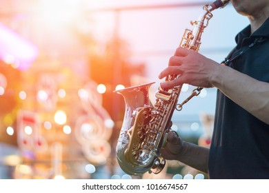 jazz festival. Saxophone, music instrument played by saxophonist player musician in fest.