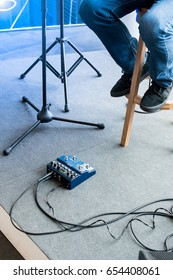 Jazz guitarist using looper pedal during live solo on stage