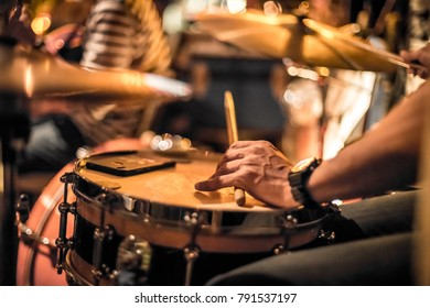 Jazz trio's drummer keeping it in time.