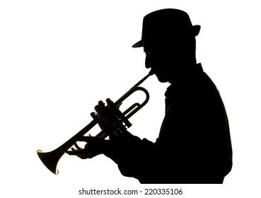 jazzman playing trumpet, silhouette