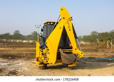JCB machinery  parking in field, Utility machine used for soil work.