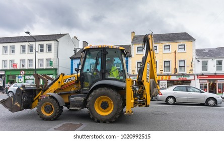 a JCB tractor in the city, taken at Longford town, Longford, Ireland, on July 27, 2017.