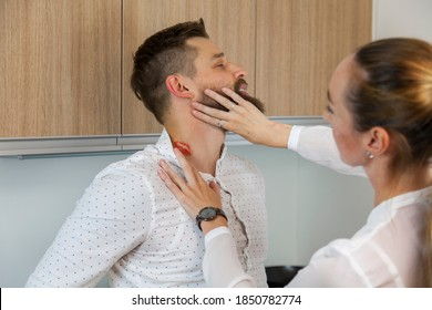 Jealous wife explores lipstick love bite on the neck of her husband