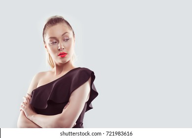 Jealousy. Closeup displeased pissed off angry young woman arms crossed bad attitude turned looking back envious isolated white background Negative human emotion facial expression feeling body language