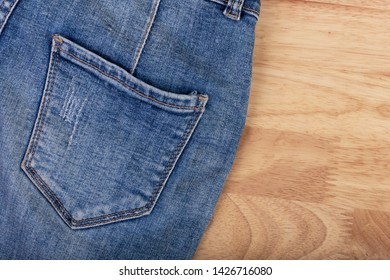The jean texture of the clothes