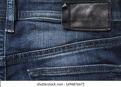 Jeans back side texture with black leather label.