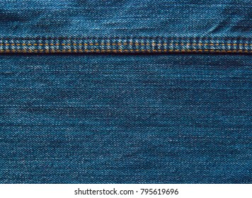 Jeans background, denim with seam of fashion design. vintage texture