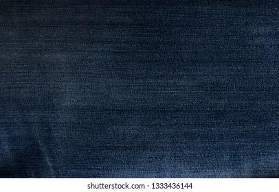 Jeans background. Jeans texture close-up. Blue jeans.