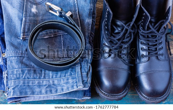 Jeans, belt and work shoes. Haberdashery. Top photo of pants.