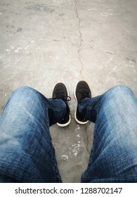 Jeans and black shoes