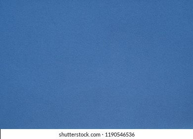 jeans blue paper texture background. colored cardboard fibers and grain. empty space concept.