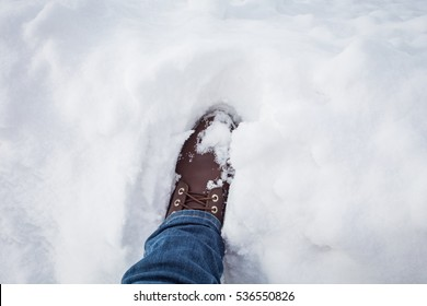 Jeans and boots on the snow.