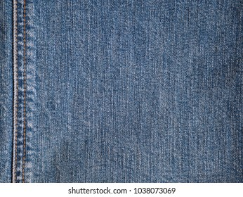 Jeans cloth fabric pattern background. Closedup blue jeans textile style for background.