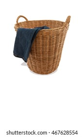 Jeans clothes on wood basket for stock laundry on isolated on white background.