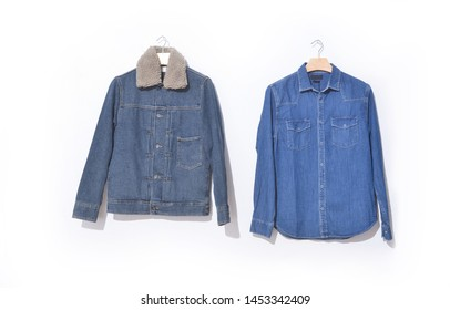 Jeans denim jacket and long sleeve blue shirts on hanging