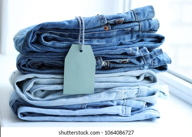 jeans of different colors are stacked in an ideal pile. jeans in the store. sale.
