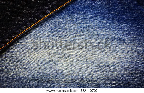 Jeans in different colors, textures, background.