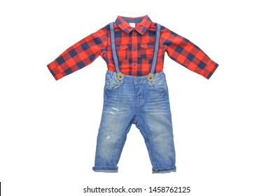 Jeans isolated. Trendy stylish denim pant or trousers for child boy with blue striped suspenders and a red checkered shirt with long sleeves isolated on a white background. Childrens summer fashion.