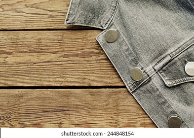 jeans jacket on a wooden background