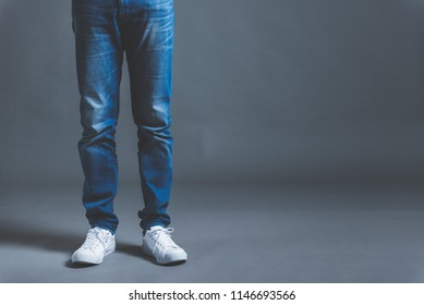 Jeans and male feet